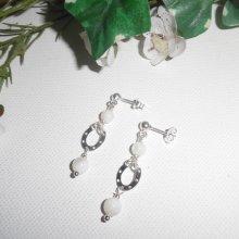 Boucles d'oreilles en perle de nacre avec fer à cheval sur clous en argent 925