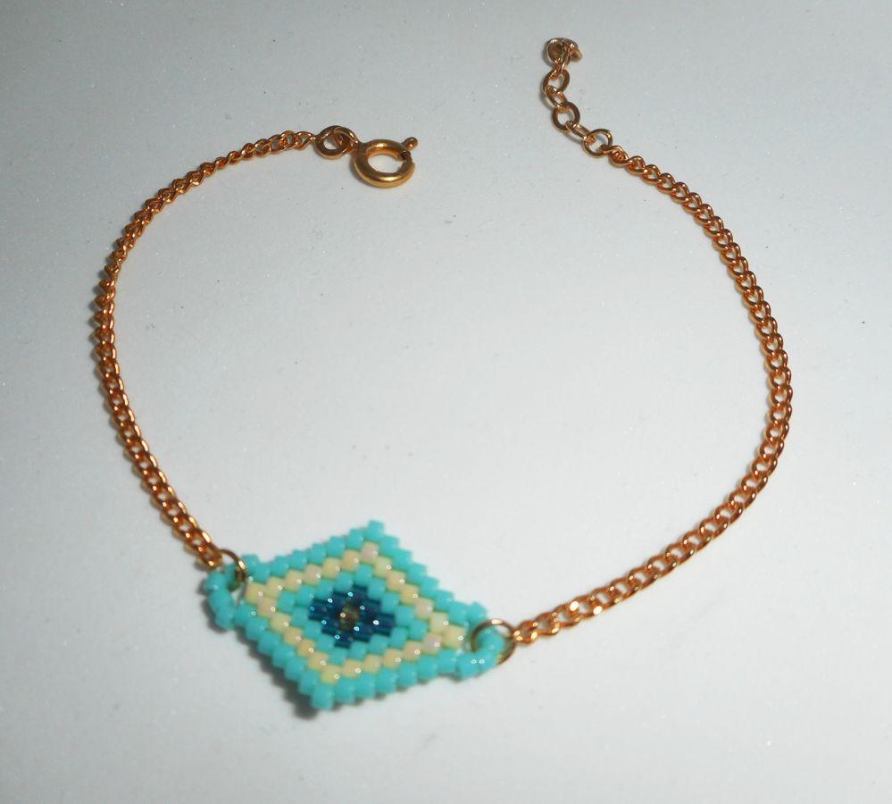 Bracelet losange tissé en perles de miuki turquoise sur chaine plaqué or