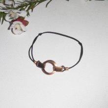 Bracelet en plaqué or avec cercle sur cordon élastique noir réglable