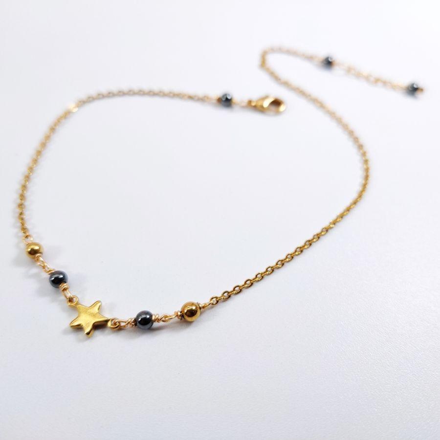 Chevillère 1 étoile en acier inoxydable doré avec pierres en hématite