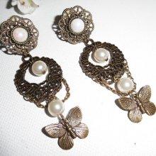 Boucles d'oreilles originales clips avec perles de verre et papillons