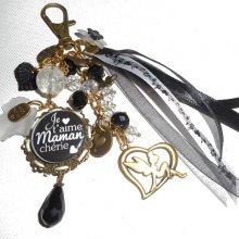 """Bijoux de sac/porte clefs avec message """"je t'aime maman chérie""""et perles noires et blanches"""