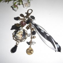 Bijoux de sac/porte clefs arlequin avec perles en cristal blanc et noir et rubans
